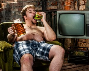 fat man drinking beer and eating burger, make healthier choice with Progentra