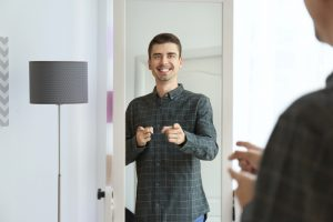 confident man happy with his image in the mirror