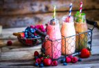 berry smoothies in bulb glasses