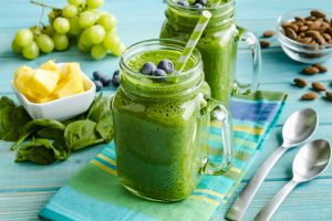 green healthy kale and spinach smoothie with blueberry