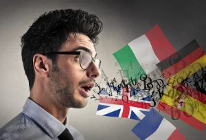 multilingual man speaking different languages, international flags