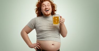 man with exposed beer belly excited after hearing about Progentra pills