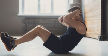 man doing crunches, sit ups