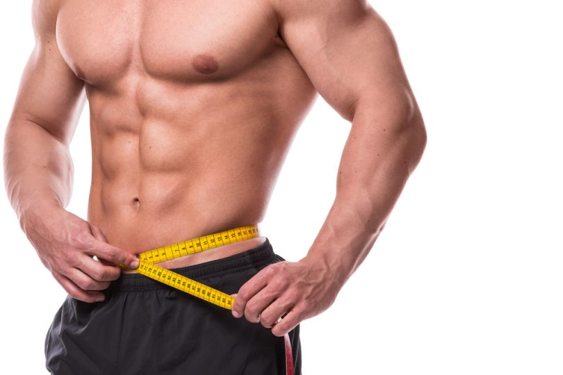 ripped guy measuring waist also started taking Progentra