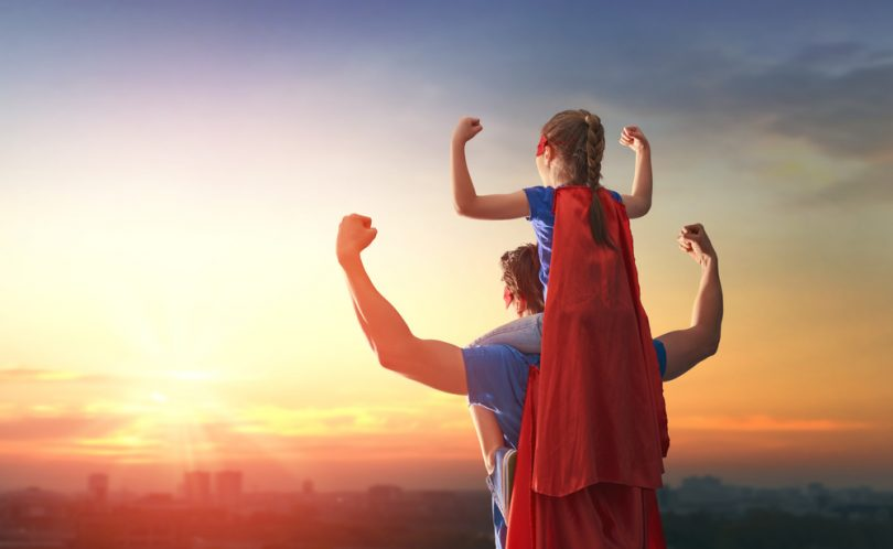 super dad because of Progentra carry daughter on shoulders