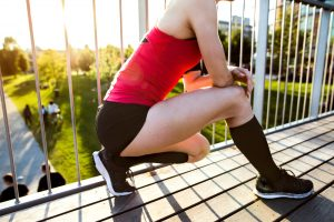 woman wearing compression socks stretching her legs
