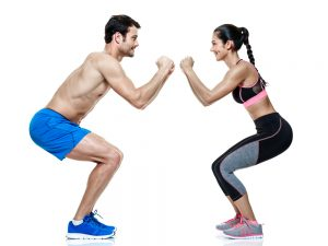 fit couple doing squats