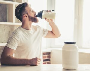 man who uses Progentra drinking protein meal replacement