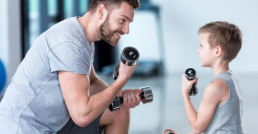 father who takes Progentra exercising with son