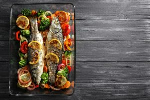 baked fish and vegetables for nordic diet meal