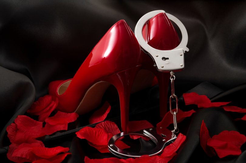 red heels and handcuffs for BDSM of Progentra user