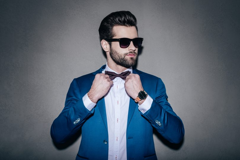 man who takes Progentra wearing a suit and sunglasses on