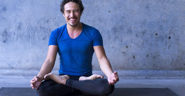 happy man in a yoga pose