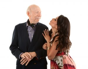 young woman kiss old man